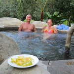 Friends eating starfruit we picked there, in their hot springs