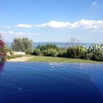 Sitting by the pool at Abbraccio del Lago, with the most amazing views of Lake Bracciano