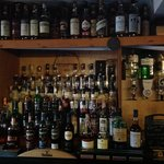 about 100 whiskeys behind the bar