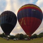 Hot air balloons launching from the grounds.