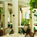 The sunny Garden Room where breakfast is served