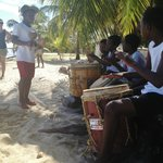 Lebeha Drumming Center's kids playing on the beach in front of the cabanas.