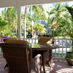 Enjoy outdoor dining on veranda with view of tropical gardens