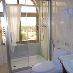 Bright, sun-lit bathroom features a picture window!