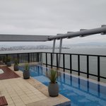 The rooftop pool offers a spectacular view of Florianopolis