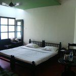 Beautiful deluxe room with a view of the green paddy fields..