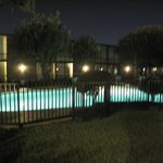 Clean outside pool at night