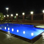 Relax by our pool at night.