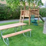 Picnic table and play structure.