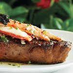 Dry-Aged Prime New York Strip with King Crab and Caviar Topping