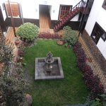 Lovely garden and fountain with hotel surrounding