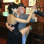 My husband dancing Tango at a Caminito Bar with a tipical tango dancer!