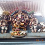 Lord Statues showing Ganesha being offered fruits and coconuts