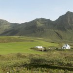 View of Nordur-Vik Youth Hostel and surrounding landscape