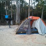 Each site has a sandy patch where you can set up your tent. We strung up rope between the trees.