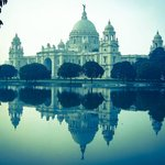 Victoria Memorial reflects in the lake waters