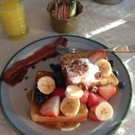 French toast with fresh fruits and whipped cream