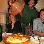 Adil serves the tajine with a flourish and a big smile!