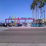 Entrance to the Imperial Beach Pier with car show...