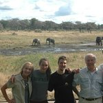 And a few feet away from the tree in my other pic my family with a couple of our elephant neighb