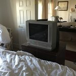 Antique TV at foot of bed