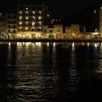 Xlendi bay at night. Walk to the end of the pier for the best restaurants.
