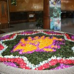 this flower petal is changed every day and done by hand . it is in the lobby