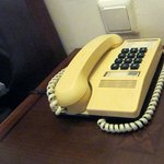 A yellow phone which was once white