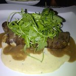 NY strip served with polenta and arugula