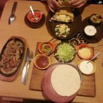 Chicken fajitas and taco platter