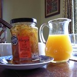Freshly squeezed orange juice and local marmalade.