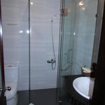A Bathroom with a Shower Stall