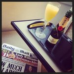 Complimentary mini bar and newspaper delivery in the Club Room Suite
