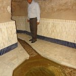 Hotel manager showing off the qanat underneath the hotel