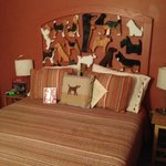 Dennis' famous chain saw doggies as the headboard