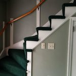 Steep stairs leading to the upstairs bedroom