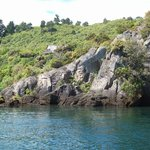 Maori rock carvings on the lake shore