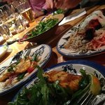 Our tasty 2nd course -- calamari, skewered chicken, haloumi pizza, salads and more