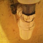 Pipework under sink in downstairs ladies toilet. Filthy.