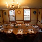 The Delft Room can comfortably seat 10 to 12 guests at a beautiful, antique pine rectangular tab