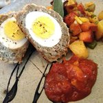 Scotch eggs with root vegetable hash, sweet garden chutney, balsamic drizzle