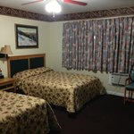 Foto Travelers Inn & Suites