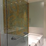 gorgeous italian mosaic tile art over the large soaker tub