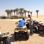 Hiring the quad bikes outside the hotel. Great fun!