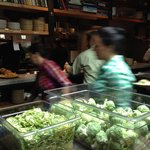 Bustling Kitchen prep with fresh Brussel sprouts