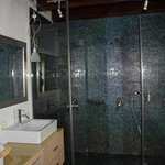The large shower in the upper bathroom