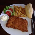 The very tasty and superbly crumbed pork schnitzel