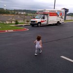 kiddo walking to our uhaul! safe parking. :)