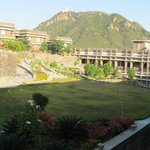 grounds of hotels with luxury suites in background monsoon palace in background