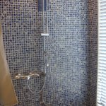 Very large tile shower with rain shower head